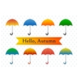 Colorful umbrellas on a rainy background vector image