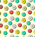 Seamless pattern of bright multi-colored donuts vector image