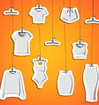 Background with stickers of modern clothes hanging vector image
