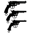 three silhouettes of retro revolvers vector image
