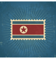 Retro North Korean Flag Postage Stamp vector image