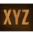 Alphabet made of wood vector image