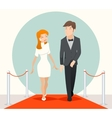 Celebrities couple walking on a red carpet vector image