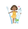 Girl Holding Giant Toothpaste Tube And Toothbrush vector image