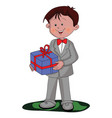 boy holding a gift box vector image