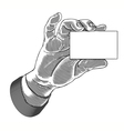hand holding white blank card in engraved style vector image