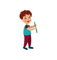 smiling little boy character holding toothbrush vector image