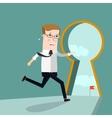Businessman entering keyhole Business concept vector image