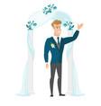 Happy groom standing under the wedding arch vector image