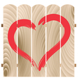 painted heart on wooden fence vector image