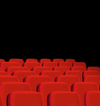 Rows of red cinema seats on a black background vector image