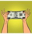 Female hands holding a hundred dollar bill vector image
