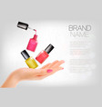manicured hands and several nail laquer bottles vector image