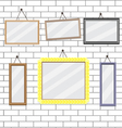 Set of picture frames on brick wall template vector image