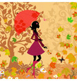 woman under an umbrella in the autumn vector image