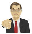 angry mature businessman pointing finger at you vector image