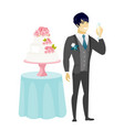 groom standing near cake with glass of champagne vector image