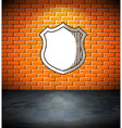 Shield on the brick wall vector image