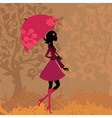 woman under an umbrella in the autumn vector image vector image