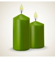 Two burning green candle isolated vector image