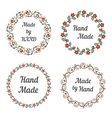 Handmade labels with wreaths vector image