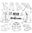 Autumn season clothes set Hand drawn doodles and vector image