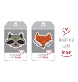 Set of two tags with knitted animals vector image