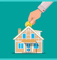 hand put coin in piggy bank house vector image