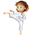 A young girl showing her karate moves vector image