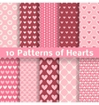 Heart shape seamless patterns tiling vector image