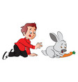 boy hungrily looking at rabbit eating a carrot vector image