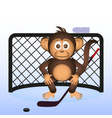 cute chimpanzee playing ice hockey sport little vector image