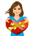 woman handing over a heart shaped box vector image