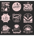 Seafood Emblem Set On Dark vector image