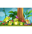 Frogs sitting on the grass vector image