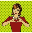 Pop art retro style woman showing heart hand sign vector image