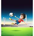 A boy in a red uniform at the soccer field vector image