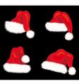 Winter Santa claus hats set vector image