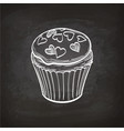 Cupcake sketch on chalkboard vector image