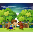 A boy and his pet playing outdoor vector image