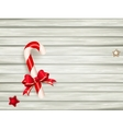 Candy cane on wooden board EPS 10 vector image