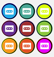 Cassette icon sign Nine multi-colored round vector image