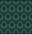 seamless pattern with laurel branches on a blue vector image