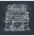 Hand drawn stack of suitcases on blackboard vector image