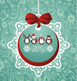 Christmas ball with penguins vector image