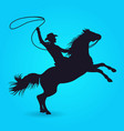 silhouette of cowboy with lasso riding on horse vector image