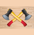 two crossed axes on a wooden background vector image