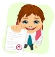 schoolboy showing his test paper vector image