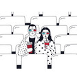 trendy young couple in cinema fashionable guy and
