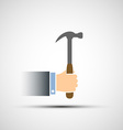 Hand holding a hammer vector image